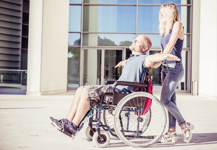 Woman and his boyfriend on the wheelchair going out